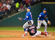 CLEVELAND, OH - NOVEMBER 2, 2016: Carlos Santana #41 of the Cleveland Indians reaches second on an error by Javier Baez #9 of the Chicago Cubs during Game 7 of the 2016 World Series between the Chicago Cubs and the Cleveland Indians at Progressive Field on November 2, 2016 in Cleveland, Ohio. (Photo by Jean Fruth)