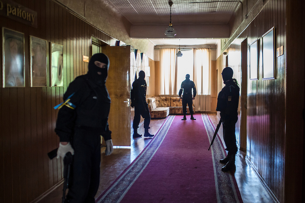 DOBROPILLYA, UKRAINE - MAY 21:  Members of the Donbass Battalion, a pro-Ukraine militia, secure a hallway while meeting with the head of the District State Administration to ensure the integrity of the upcoming presidential election on May 21, 2014 in Dobropillya, Ukraine. Days before presidential elections are scheduled, questions remain whether the eastern regions of Donetsk and Luhansk are stable enough to administer the vote. (Photo by Brendan Hoffman/Getty Images) *** Local Caption ***