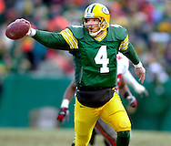 (2000)-Green Bay's Brett Favre fakes a pitch during a 3rd quarter run for a first down against the Tampa Bay Buccaneers.