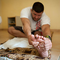 2/07/2012. Senegal, Dakar. One day with the White Lion.    The canarian wrestler Juan Espino, the unique white fighter in the senegalese wrestling. Stretching time in the morning before his fight .  ©Sylvain Cherkaoui