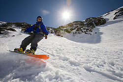 A snowboarder in Tuckerman Ravine in New Hampshire's White Mountains. White Mountain National Forest. April. (MR)