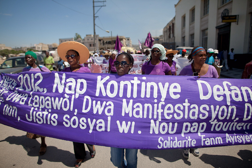 Women from Haitian Women's Solidarity (SOFA). SOFA is calling for the defense of civil liberties (free speech, the right to protest), an end to impunity for ex-dictator Jean Claude Duvalier, the withdrawal of UN troops and for social justice for women. (Photo by Ben Depp)