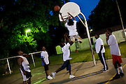 Young men play basketball late at night in the Baptist Town neighborhood of Greenwood, Mississippi on Tuesday, May 18, 2010.