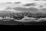 Winter storm clouds build around Mount Constitution, located in the Olympic mountain range in Washington state. This black and white image was captured from Richmond Beach in Shoreline, Washington.