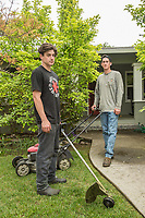 """""""I work for my dad but eventually I want to go off the grid.""""  Donnie McMahon and his younger brother, Jackson, finish up a lawn at the corner of Berry and Myrtle Street in Calistoga."""
