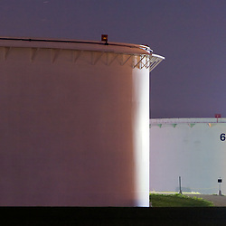 Two giant oil storage tanks amongst a tank farm along a pipeline in the far Chicago suburbs.