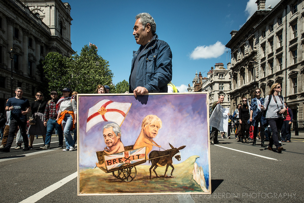 A painter trying to exploit his skills and advertise himself. Tens of thousands of people marched in central London on 2nd of July protesting against the results of the Referendum that called UK outside the European Union.