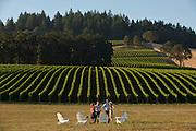 Couples enjoying wine tasting at Stoller Vineyards, Dundee Hills, Willamette Valley, Oregon.