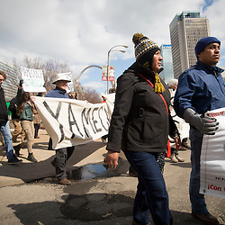 FRIDAY, MARCH 26, 2015 - Supporters of 43 students who disappeared in September 2014 from the Raúl Isidro Burgos Rural Teachers' College of Ayotzinapa in Iguala, Guerrero, Mexico, marched Friday through downtown St. Louis. Some in the group are making their way across the United States to spread their message that the Mexican government is ignoring their demands for justice, transparency and accountability. In the front are Maria De La Cruz (center) whose son, Jesus Tlamtepa, disappeared and Cruz Bautista,Tlamtepa's uncle. NOTE: THE SPELLING OF THE NAMES IS QUESTIONABLE DUE TO LANGUAGE DIFFERENCES ©Photo by Jerry Naunheim Jr.