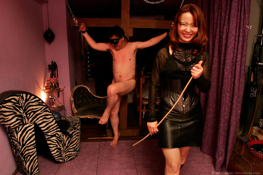 "DOMINATRIX CLUB ""LA SIORA"" at Shinjuku - Tokyo - Submisive client with Dominatrix Ria  during an S&M session. .La Siora is one of the oldest dominatrix houses in Tokyo, it was conceived xxyears ago and boasts an impressive client base of 4000 slaves, wanting to get whipped for fun. Basically paying clients come here from a variety of backgrounds to indulge in their fantasies at 30000 yen a pop (p/hour)..Rie is the manageress and head dominatrix of the establishment. When we asked her why she ever got into SM, she replies quite simply she thought it looked cool and she likes to try new things. Her specialties are whipping and shibari- Japanese rope bondage which she explains is an art unto itself that requires, months to years of practice and training. Her manner is impeccably polite, and her demeanor is pleasant, which makes her profession all the stranger given her friendly manner."