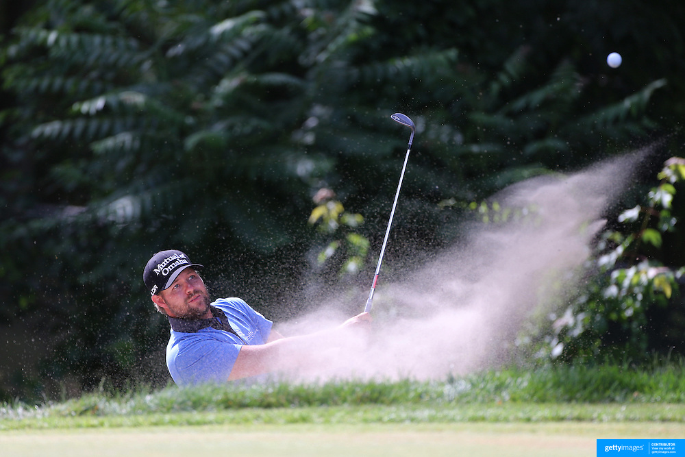 Ryan Moore, USA, plays out of a bunker during the final round of the Travelers Championship at the TPC River Highlands, Cromwell, Connecticut, USA. 22nd June 2014. Photo Tim Clayton