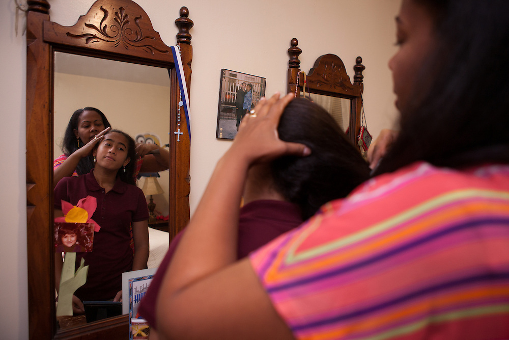 Yokayra Fernandez-Haghighi helps her daughter Victoria Haghighi, 12, get ready for school in their apartment in Fordham Heights, The Bronx, NY on September 11, 2013.