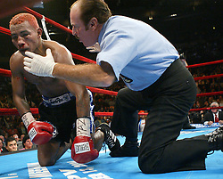 October 2, 2004; New York, NY; USA; Referee Steve Smoger counts over a fallen Ricardo Mayorga during Mayorga's bout against Felix Trinidad at Madison Square Garden in New York City.