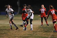 Oxford High vs. Lafayette High's Maddy Houghton (20) in girls soccer action on Tuesday, December 10, 2013. The match ended in a 5-5 tie.