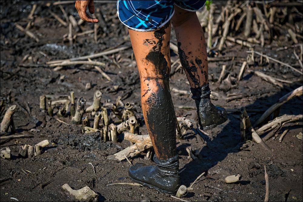 Karina Jacany's legs covered in fishpond mud.