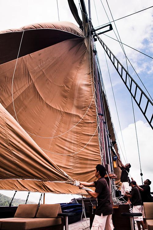 Lowering the sails on Alila Purnama.