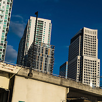 In an optical illusion, high rise buildings appear to slide down a bridge in downtown Miami, Florida.