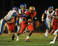 Lafayette High's D.K. Buford (2) vs. Memphis University School's Trey Moore (6) in Oxford, Miss. on Friday, September 27, 2013. MUS won.