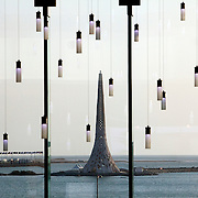 "The ""Beacon"", a 60-meter contemporary interpretation of a lighthouse standing at the Red Sea entrance of the King Abdullah University of Science and Technology (KAUST) is seen framed by lighting fixtures hanging in the campus library September 21, 2009  in Thuwal, Saudi Arabia (about 80 kilometers north of Jeddah.) KAUST is an international, graduate-level research university dedicated to inspiring a new age of scientific achievement in the Kingdom that will also benefit the region and the world. Handout photo by Scott Nelson"
