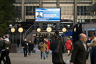 UK. London. Canary Wharf underground station. Commuters arrive for work in London's modern business centre..Photos ©Steve Forrest/Workers' Photos