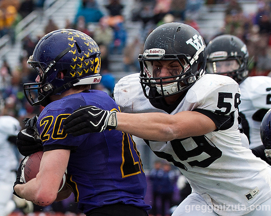 Vale's Garret DeVos moves in to tackle Harrisburg's Hunter Knox during the first quarter of the Oregon 3A State Championship at Kennison Field, Hermiston, Oregon. November 29, 2014. Vale defeated Harrisburg 45-19 to win the 3A State Championship and finish with a 12-0 season record.<br />