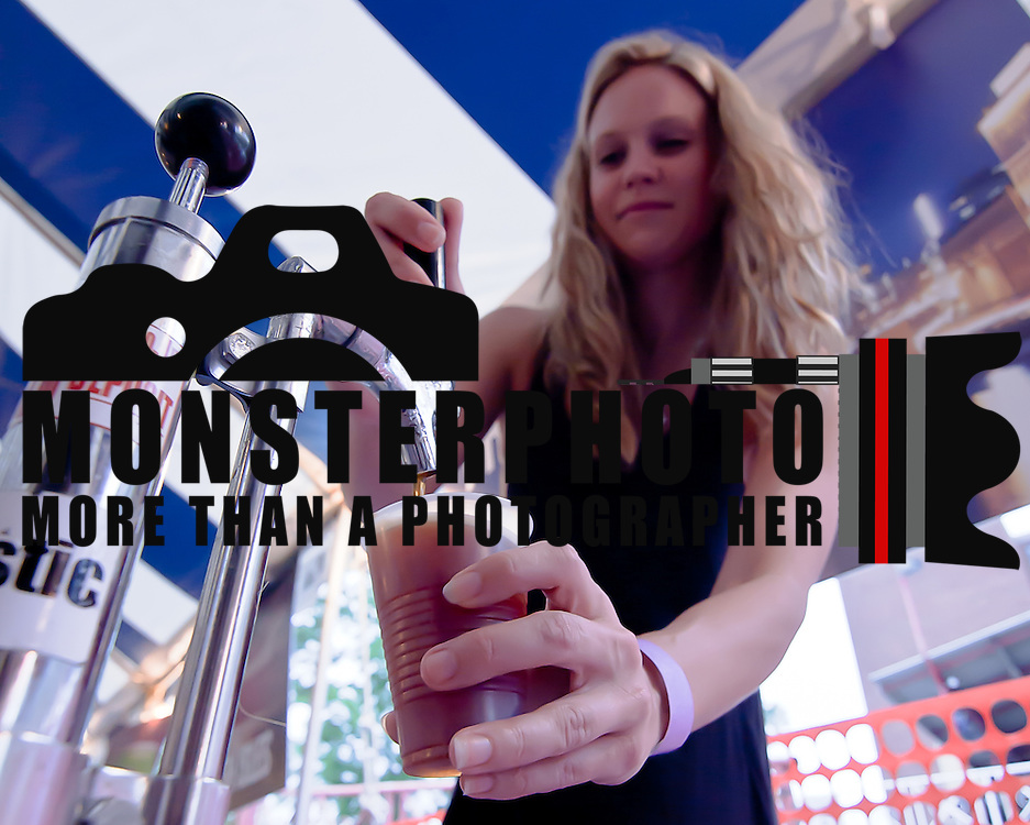06/11/12 Wilmington Del: Cicerone-certified beer server Lyadee Baldwin pours a sample of 16 mile amber sun of attendees during the inaugural International Beer Tasting Event Monday, June 11, 2012, at St. Anthony's Italian Festival in Wilmington Delaware...Special to The News Journal/SAQUAN STIMPSON