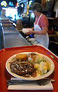 Germantown Cafe: A plate lunch of Pepper steak, mashed potato with gravy, steamed broccoli and cauliflower and a corn muffin.