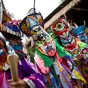 Thai school children wait to perform during festivities at Thailand's Phi Ta Khon Ghost festival Friday, June, 22nd, 2012, in Dan Sai, Thailand.  The Dan Sai Ghost Festival is unique to the Isan area of Thailand in the east and is part of local beliefs in spirits and ghost and is also a Buddhist merit making festival.  The ghost masks are made from bamboo sticky rice cookers and the costumes usually strips of cloth sewn together.  The origins of the Phi Ta Khon Festival are said to come from Buddha's last great incarnation before attaining Enlightenment.