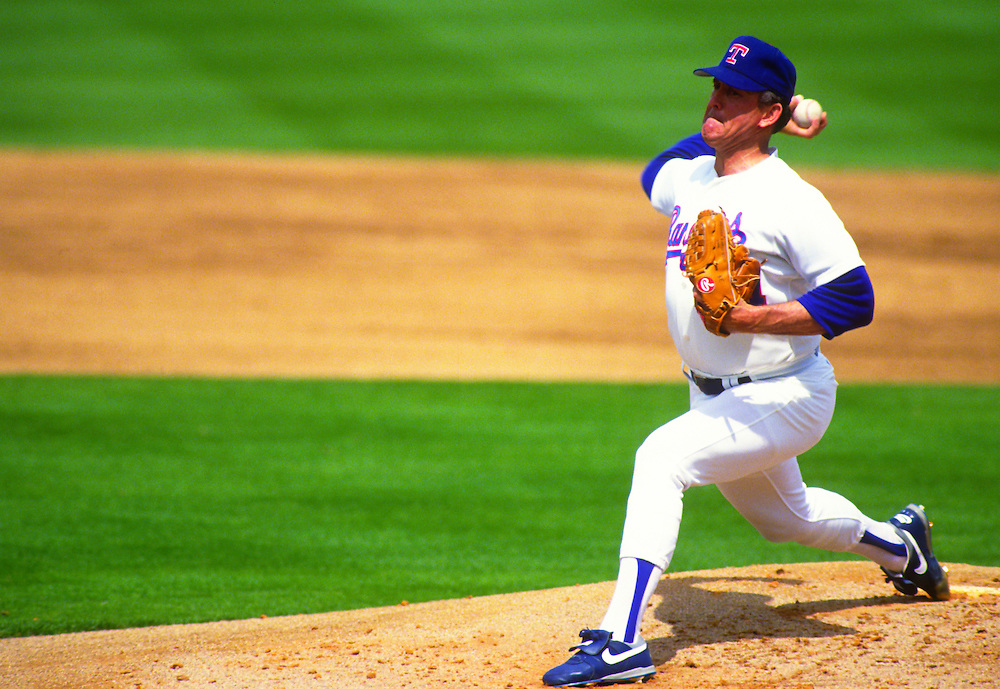 PORT CHARLOTTE, FL-UNDATED: Major League Baseball Hall of Fame pitcher Nolan Ryan pitches during a game in Port Charlotte, Florida.  Ryan pitched for the Texas Rangers from 1989-1993. (Photo by Ron Vesely)