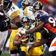 SHOT 1/8/12 5:00:33 PM - The Denver Broncos Jason Hunter #90 tackles the Pittsburgh Steelers Isaac Redman #33 during their AFC Wildcard game at Sports Authority Field at Mile High on Sunday January 8, 2012. The Broncos won the game in overtime 29-23. (Photo by Marc Piscotty / © 2012)