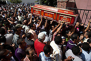 Egyptian Coptic Christians prepare caskets for victims of sectarian violence October 10, 20011 at the Coptic Hospital in Cairo, Egypt. At least 26 people, mostly Christian, were killed during sectarian clashes that saw the worst violence since the Revolution that toppled former Egyptian president Hosni Mubarak earlier this year. Egyptian Coptic Christians make up about 10% of Egypt's 80 million population and periodically violence flares between the Christian minority and the majority Muslim population. (Photo by Scott Nelson).