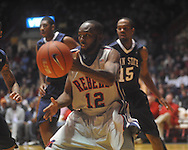 """Ole Miss guard Chris Warren (12) passes at the C.M. """"Tad"""" Smith Coliseum on Friday, November 26, 2010. Ole Miss won 84-71."""