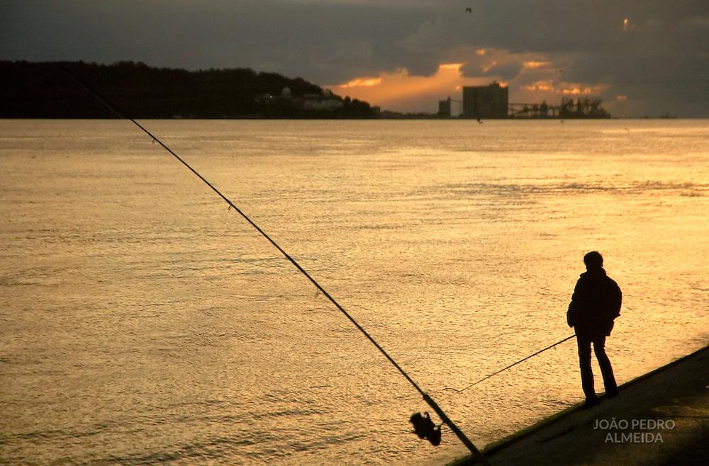Man fishing at Tagus river at Lisbon