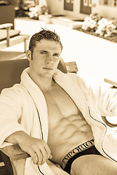 hot man in a lounge chair in an open robe and briefs