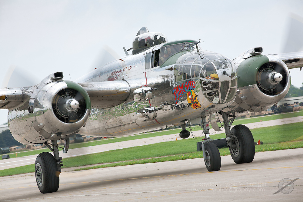 Larry Kelley and Gary Sinise taxi B-25 Panchito leading the Veteran's Parade...Disabled American Veterans Parade activities involving Vietnam Veteran and triple-amputee, Jim Sursely, B-25 'Panchito' owner and pilot, Larry Kelley and actor Gary Sinise.
