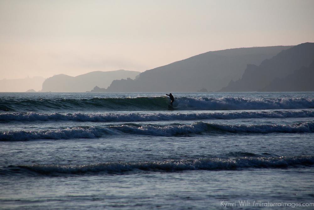Europe, United Kingdom, Wales, Pembrokeshire. Surfer on wave at Freshwater West Beach in Pembrokeshire.