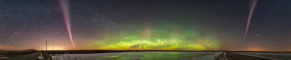 A panorama from west (left) to southeast (right) of an aurora display, March 2, 2017, from southern Alberta, with a classic aurora oval to the north, and the odd-looking isolated arc to the west and east (and it passed overhead) glowng pink in color, with a bare hint of green fringe. These arcs are not uncommon but seem to be unique to latitudes far to the south of the main auroral oval. In this case, the arc was overhead for us at 51&deg; North, while the main oval was 5&deg; to 10&deg; farther north. <br /> <br /> Jupiter is rising to the right of the eastern arc. Orion is setting at far left. <br /> <br /> This is a stitch of 8 segments, each with the 20mm Sigma lens at f/2 for 20 seconds each at ISO 3200, rather long but I wanted to bring out the faint isolated arc.