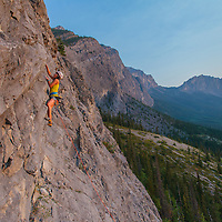 Samira Leading LED Sheep a 4 pitch 5.10b on Kid Goat with Mt Yamnuska in the background