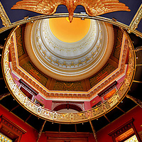 New Jersey State House Capitol Rotunda in Trenton, New Jersey<br /> Stained glass, eagles, gilded ribs and historic portraits surround the rich reds and blues of the rotunda at the New Jersey State House in Trenton. This is the second oldest capitol in continuous use. The view of the 145 foot dome is shaped by golden, ornamental grillwork in an octagon shape. It&rsquo;s an excellent example of American Renaissance architecture.