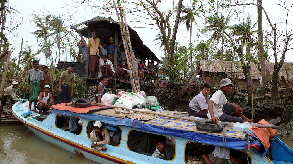 Private Burmese donators from Rangoon trying to bring aid to the Delta people with their few means, in the aftermath of Cyclone Nargis. Many people from Rangoon tryed to help the Delta villagers as their goverment did not bring them any help or support.