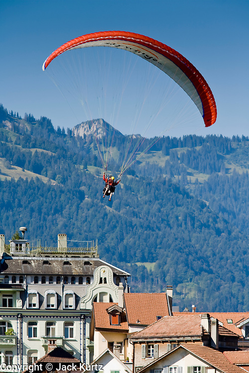 01 AUGUST 2007 -- INTERLAKEN, BERN, SWITZERLAND: Parasailers fly into the park in Interlaken, Switzerland. Interlaken, in the canton of Bern, is the heart of the Bernese Oberland and the center of the region's tourism industry.   PHOTO BY JACK KURTZ