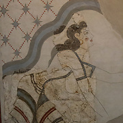 Bathing lady with exposed breast, on fresco from the archaeological site of Akrotiri, that was covered by volcanic ash in 1627 BC, Santorini, Greece.