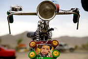 A photo of deceased and revered Northern Alliance commander Ahmad Shah Massoud adorns the front of an Afghan policeman's bike in Kabul, Afghanistan.