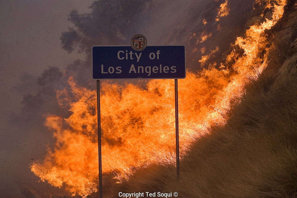A City Of LA sign on Topanga Canyon Blvd..Wild fires near Porter Ranch and Simi Valley. Over 5000 acres burned with several houses burning. 60 mph Santa Ana wind event stoked the brush fires and are expected to blow all week long.