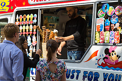 Finsbury Square, London, June 18th 2015 City workers enjoy the sunshine in Finsbury Square, buying a lunchtime ice cream as Britain's summer takes hold.