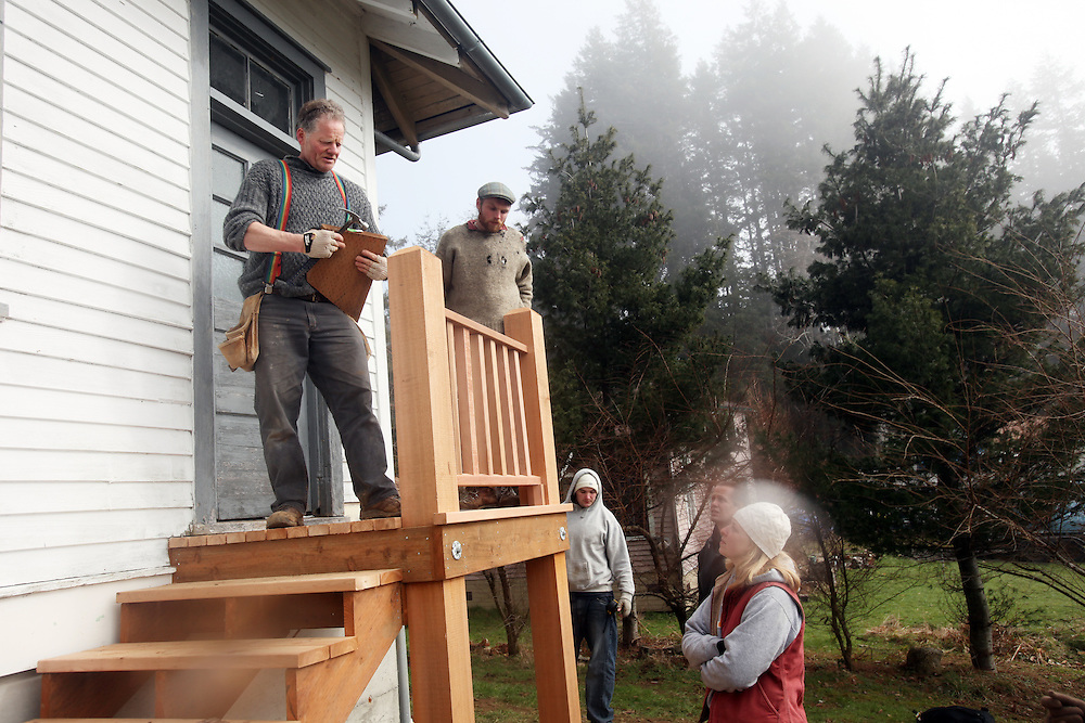 Clatsop Community College Historic Preservation students, under the supervision of their instructor Lucien Swerdloff and contractor Tim Kennedy, build staircases and railings during a workshop February 5 & 6 to replace the rotted porches on the historic U.S. Columbia River Quarantine Hospital (aka the Pesthouse) in Knappton Cove, Wash., on Sunday, March 6, 2011.