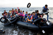 The moment of arrival is the happiest for the sea battered refugees. <br /> Refugees arriving on beaches near Molyvos village in Lesvos island. Thousands of them come from Turkey, crossing the sea border on inflatable dinghy boats, on a dangerous trip that has claimed many lives. Local people or NGOs expect them and help them in some places but after their arrival, most of them have to walk to the nearest village where they can hope for a places on busses that can take them to the city of Mytilene where they can register and eventually board on a ferry to Athens. Many decide to walk the distance as the busses aren&rsquo;t enough to accommodate the large number of people that arrive daily.