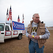 Jim Wilson, of Buckingham, VA, lights his pipe after showing his support for former Gov. Mitt Romney (R-MA) Thursday, December 29, 2011, in Ames, IA...Photo by Khue Bui