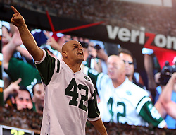 "Sept 19, 2011; East Rutherford, NJ, USA; ""Fireman Ed"" leads cheers during the 2nd half at the New Meadowlands Stadium.  The Jets defeated the Patriots 28-14."