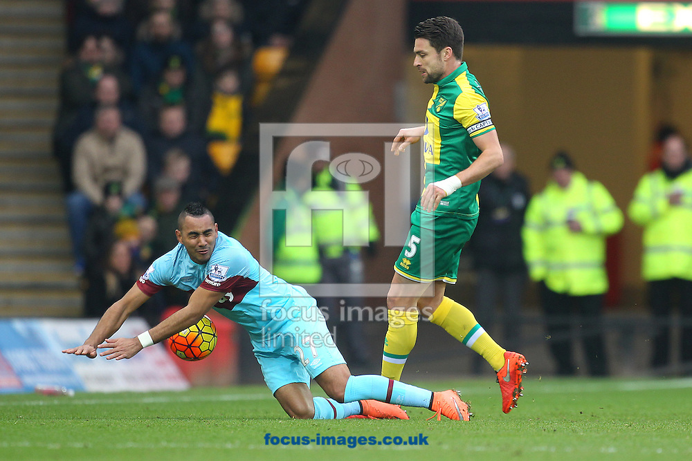 Dimitri Payet of West Ham is fouled by Russell Martin of Norwich in action during the Barclays Premier League match at Carrow Road, Norwich<br /> Picture by Paul Chesterton/Focus Images Ltd +44 7904 640267<br /> 13/02/2016